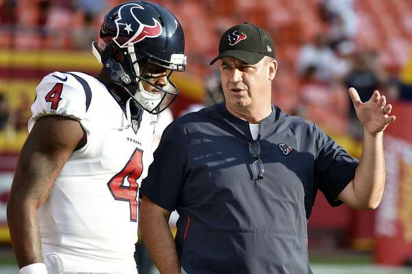 """FILE - In this Aug. 9, 2018, file photo, Houston Texans quarterback Deshaun Watson (4) listens to head coach Bill O'Brien before an NFL preseason football game against the Kansas City Chiefs in Kansas City, Mo. The Texans fired back at an East Texas school superintendent who wrote: """"You can't count on a black quarterback,"""" in the comment section of an online news article where he was criticizing Watson. O 'Brien called the comments """"outdated, inaccurate, ignorant and idiotic."""" Watson said he didn't waste time worrying about the post. (AP Photo/Ed Zurga, File)"""