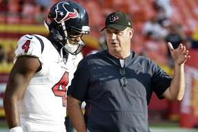 """In this Aug. 9, 2018, file photo, Houston Texans quarterback Deshaun Watson (4) listens to head coach Bill O'Brien before an NFL preseason football game against the Kansas City Chiefs in Kansas City, Mo. The Texans fired back at an East Texas school superintendent who wrote: """"You can't count on a black quarterback,"""" in the comment section of an online news article where he was criticizing Watson. O 'Brien called the comments outdated, inaccurate, ignorant and idiotic. Watson said he didn't waste time worrying about the post."""