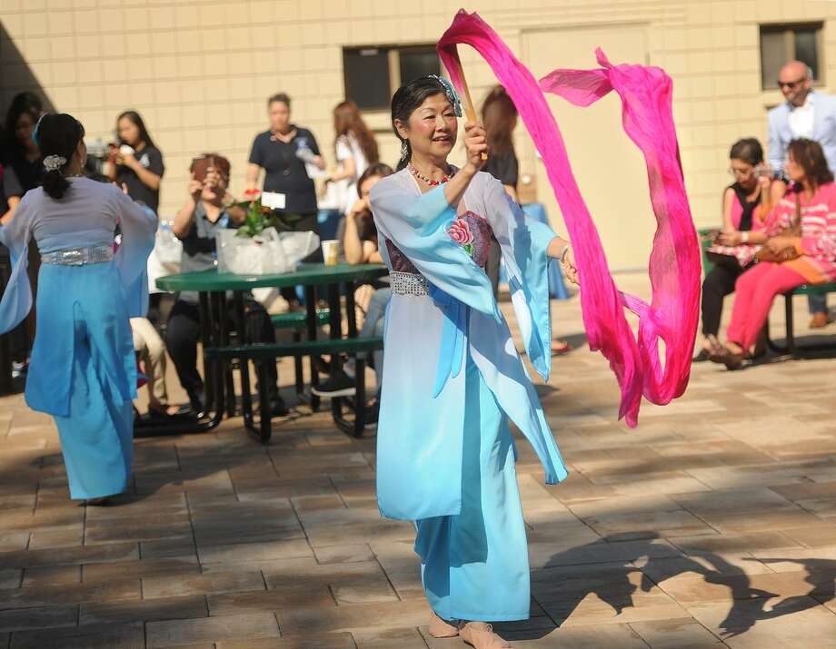 Traditional dancers from the group Asian Performing Arts entertain at the ribbon cutting celebration for Apex International Education Partners' new offices and student dormitory  in Derby on Wednesday. Photo: Brian A. Pounds / Hearst Connecticut Media / Connecticut Post