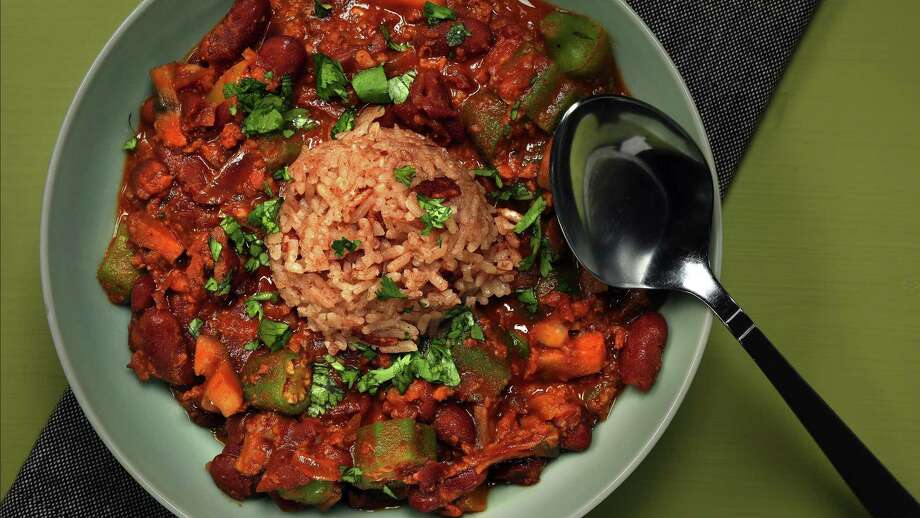 The red beans and chorizo stew tastes great topped with a scoop of red rice. Okra gives the stew additional texture. (Shannon Kinsella/food styling) (Terrence Antonio James/Chicago Tribune/TNS) Photo: Terrence Antonio James / Chicago Tribune