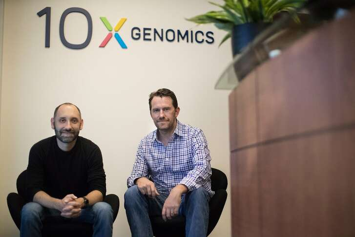 Serge Saxonov, CEO, Co-founder, and Ben Hindson, Chief Scientific Officer, President, Co-founder of 10x Genomics, which makes and sells technology to research labs and pharma companies that develop drugs, pose in their lab's lobby on Thursday, Sept. 13, 2018, in Pleasanton, Calif.