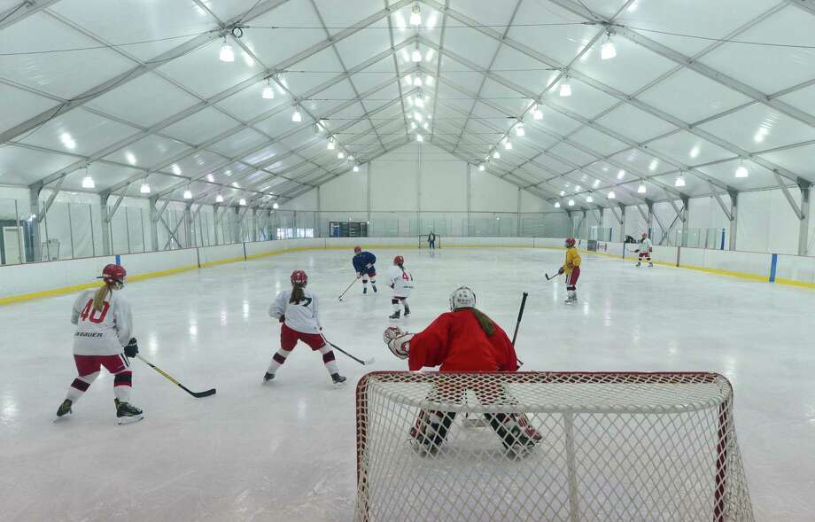 The New Canaan High School girls hockey team practices at The Rinks at Veterans Park in February 2017 in Norwalk. The Rinks at Veterans Park will not be coming back for a third season. Photo: Erik Trautmann / Hearst Connecticut Media / Norwalk Hour