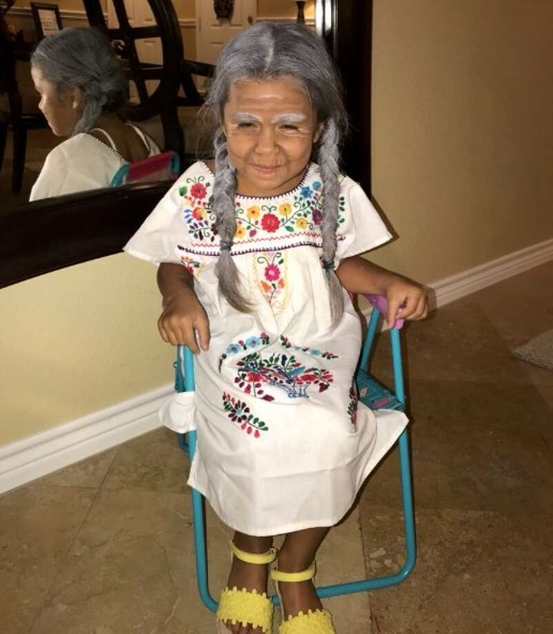 One young Houston girl is melting hearts after her brother shared photos on Twitter of her dressed up as the character 'Mama Coco' from Pixar's hit film 'Coco.' Photo: Courtesy Alejandro Rodriguez