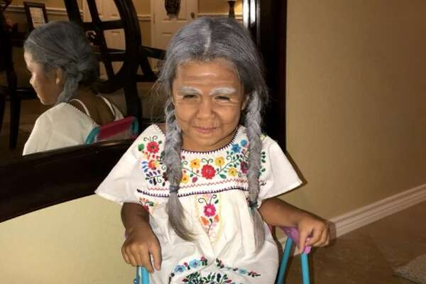 One young Houston girl is melting hearts after her brother shared photos on Twitter of her dressed up as the character 'Mama Coco' from Pixar's hit film 'Coco.'