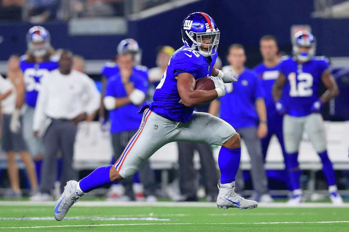 ARLINGTON, TX - SEPTEMBER 16: Saquon Barkley #26 of the New York Giants carries the ball against the Dallas Cowboys in the fourth quarter at AT&T Stadium on September 16, 2018 in Arlington, Texas.
