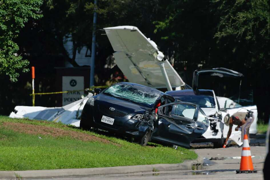 Police investigate two vehicles, a Tesla Model X and a Toyota Yaris, that were impacted when a small plane crashed on Voss Road just west of Highway 6, Wednesday, Sept. 19, 2018, in Sugar Land.
