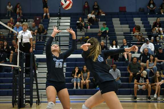Kingwood sophomore setter Jordan Rambo (23) makes a play against Seven Lakes during their match at Kingwood High School on August 18, 2018.