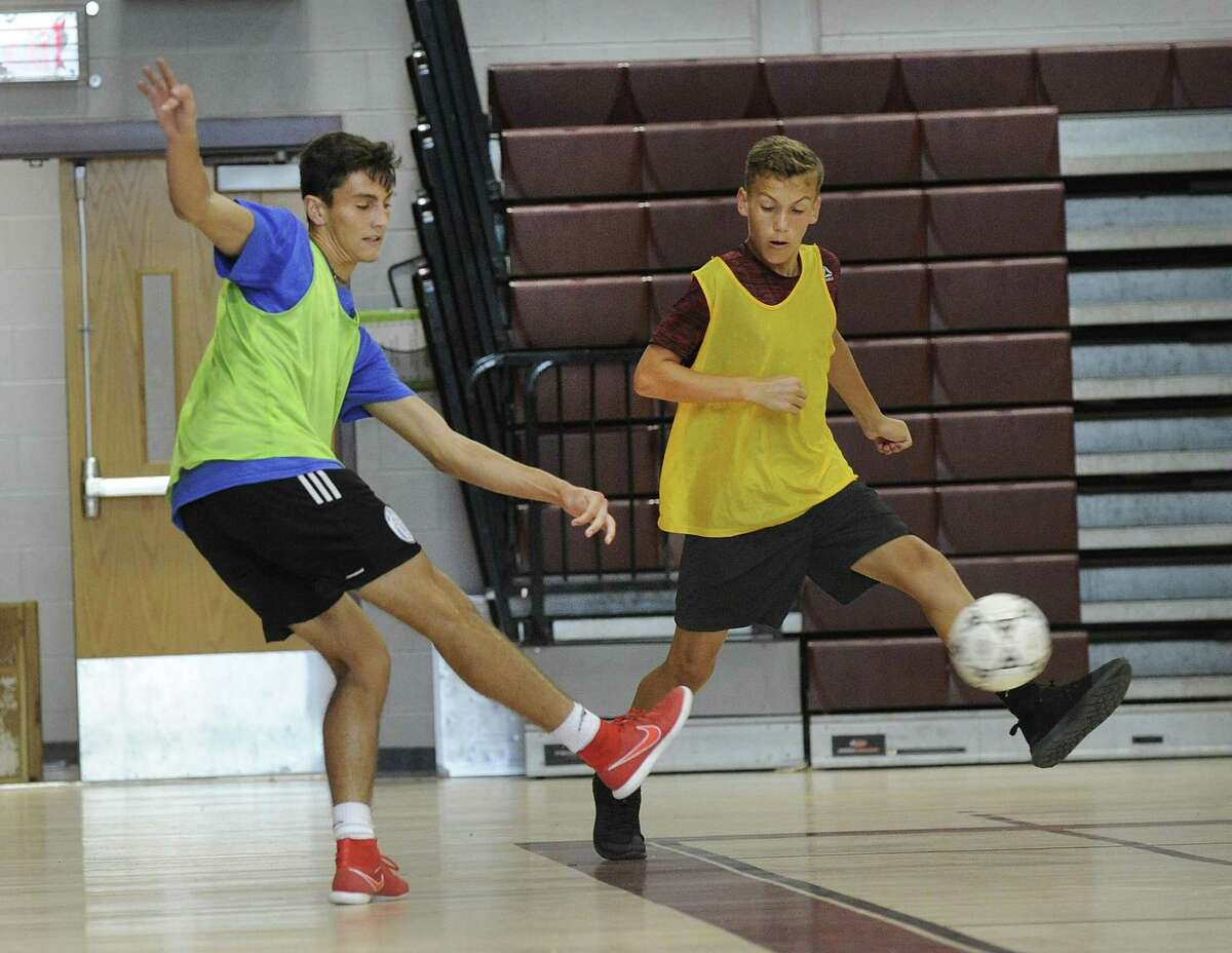Brad Bornn, 17, left, and Brian Legnard during soccer practice Tuesady, Sept. 18, 2018. The boys varsity and junior varsity soccer teams at Bethel High School practice in the school gym during inclimate weather. Without a turf field, teams are forced to cancel practice or practice inside on rainy days.
