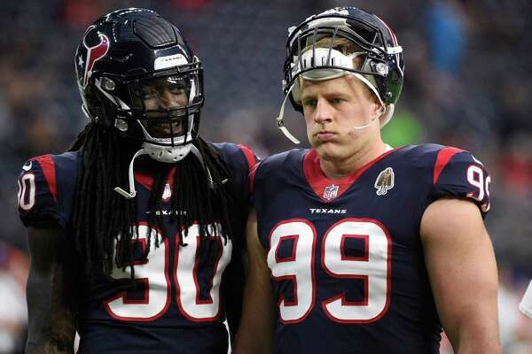 Houston Texans defensive end Jadeveon Clowney (90) and defensive end J.J. Watt (99) warms up before a preseason NFL football game against the Dallas Cowboys Thursday, Aug. 30, 2018, in Houston. (AP Photo/Eric Christian Smith)