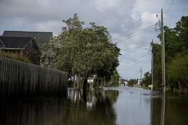 A flooded street after Hurricane Florence in Carolina Beach N.C., on Monday. The center of Florence has left the Carolinas. But the chaos that the storm unleashed is tremendous.