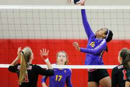 Westhill's Tamar Bellete hits the ball over the net against New Canaan on Tuesday.