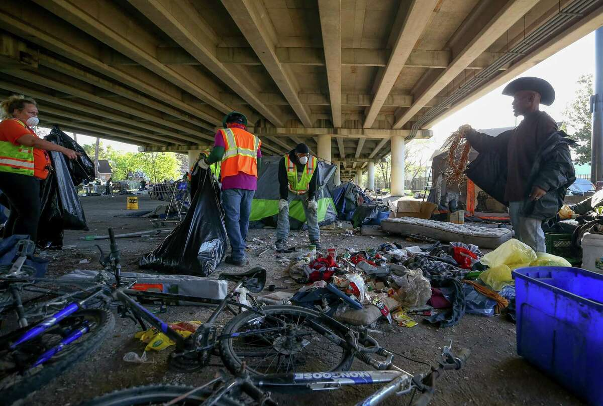 Clean up crews with the city conduct a deep cleanup of the Wheeler Homeless Encampment located under the US 59 Freeway in Houston.