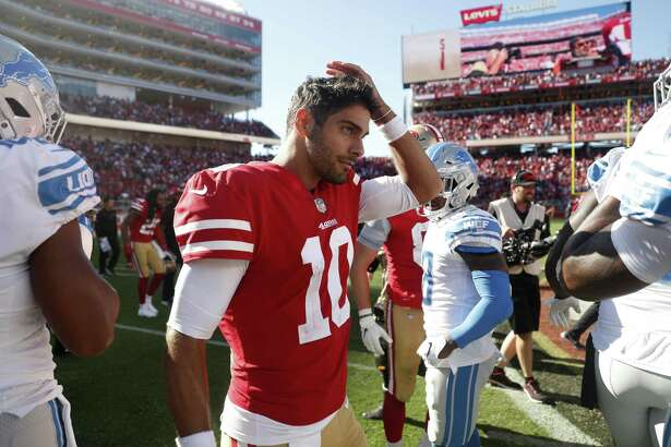 San Francisco 49ers quarterback Jimmy Garoppolo walks off the field at the end of an NFL football game against the Detroit Lions in Santa Clara, Calif., Sunday, Sept. 16, 2018. San Francisco won the game 30-27. (AP Photo/Tony Avelar)