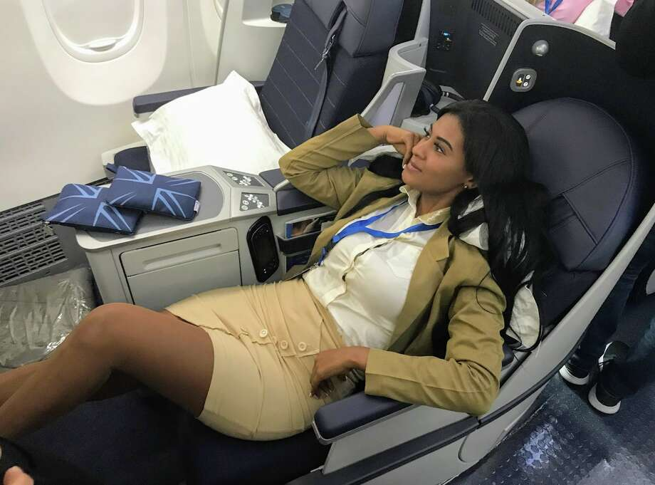 Panamanian magazine executive Arlene Murillo tries out business class. There are 16 lie flat business class seats on Copa's new 737 MAX 9 Photo: Chris McGinnis