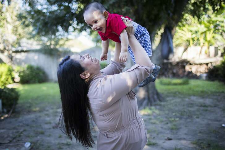 Maria Guadalupe Juarez, 28, plays with her son Isaac Juarez, 10-months-old, Wednesday, Sept. 19, 2018, in Pearland. Juarez has been in Houston for the past eleven years and since 2015 she has been a Deferred Action for Childhood Arrivals (DACA) recipient.