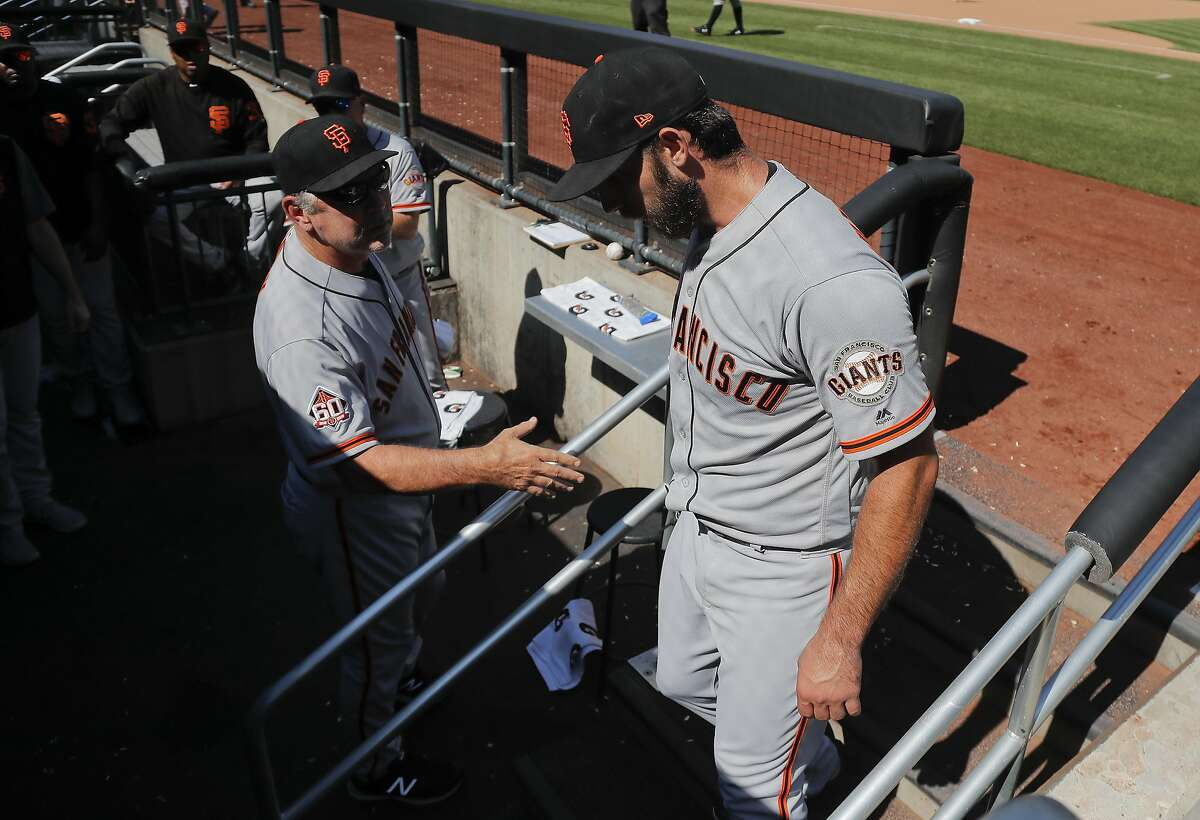 San Francisco Giants manager Bruce Bochy, left, greets starting pitcher Madison Bumgarner at the end of the seventh inning of a baseball game against the New York Mets, Thursday, Aug. 23, 2018, in New York. (AP Photo/Julie Jacobson)