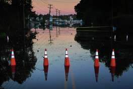 A street remains flooded at sunrise Wednesday in Fayetteville, N.C., in Florence's wake. The nearby Cape Fear River rose to more than 60 feet, causing extensive flooding throughout the area.