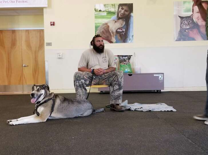 """My dog can read me,"" Houston native and Army veteran Brandon Gray says of Maximus."