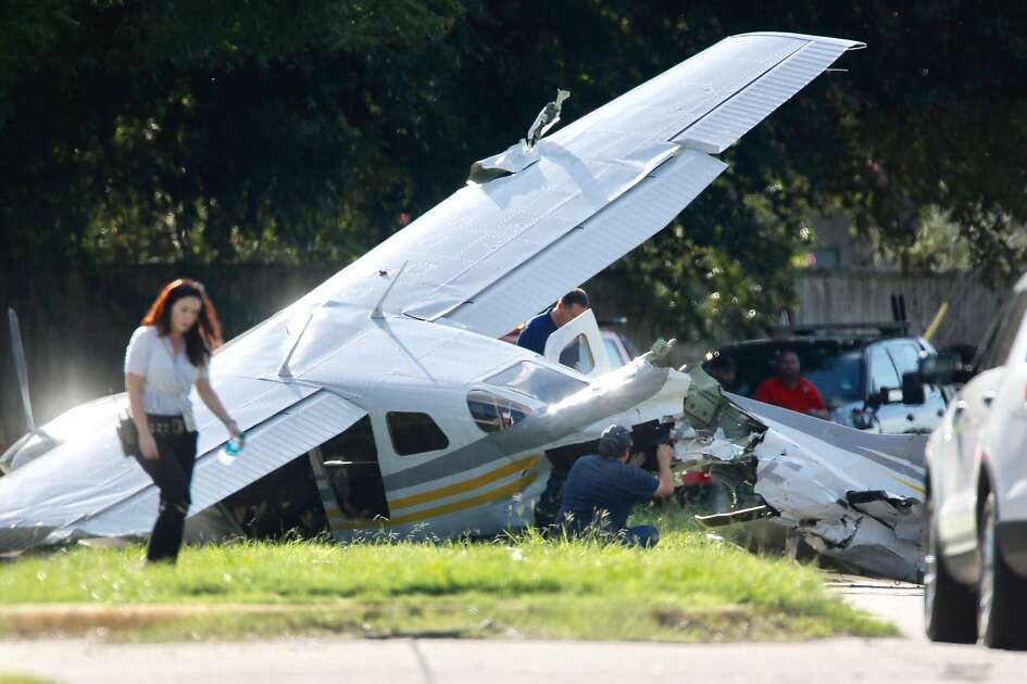 Investigators look at a small plane that crashed on Voss Road just west of Highway 6, Wednesday, Sept. 19, 2018, in Sugar Land.