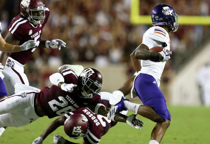Texas A&M Aggies defensive back Deshawn Capers-Smith (26) misses a tackle on Northwestern State Demons wide receiver Quan Shorts (6) during the first half of an NCAA game at Kyle Field Thursday, Aug. 30, 2018, in College Station, Texas.