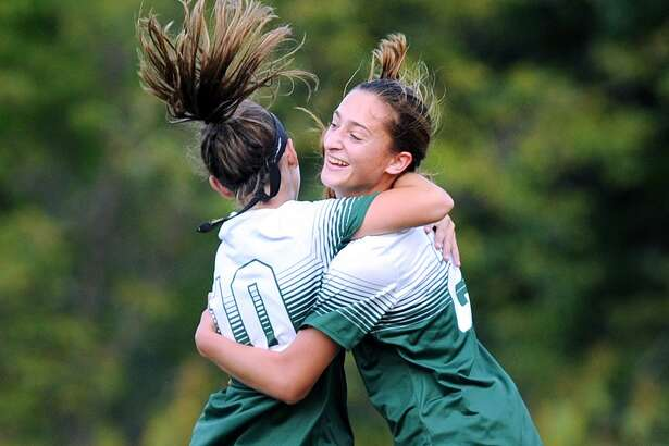 Isabel DeVita, left, of Sacred Heart Greenwich congratulates teammate Alana Frederick on scoring a first-half goal against Choate Rosemary Hall Wednesday in Greenwich.