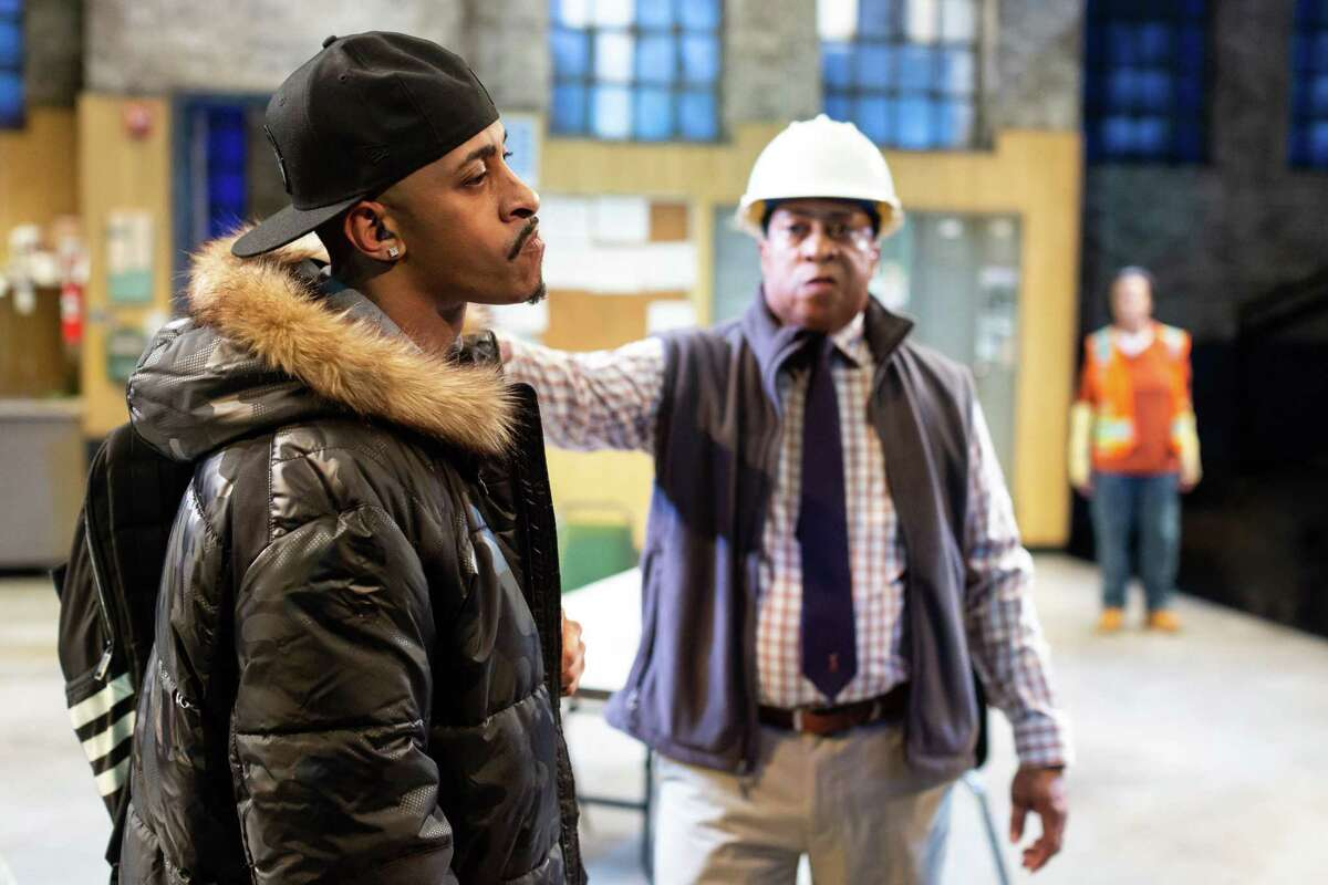 """Brandon J. Morgan and David Rainey in the Alley Theatresproduction of """"Skeleton Crew,"""" by Dominique Morisseau."""