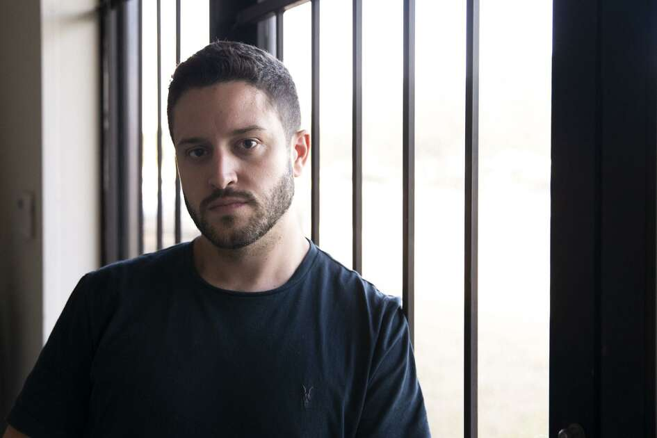 Cody Wilson poses for a portrait in the Defense Distributed office in Austin, Texas, on Tuesday, Aug. 7, 2018. The founder of Defense Distributed, Wilson has been in a long legal dispute regarding his ability to post the instructions to create 3-D printed firearms on his website. (Lynda M. Gonzalez/Austin American-Statesman via AP)
