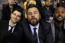 """Gary (S.A. native James Roday), center, and friends Eddie (David Giuntoli), left, and Rome (Romany Malco) try to take the edge off their grief following a pal's suicide with a silly selfie taken at a Boston Bruins game in the premiere episode of """"A Million Little Things,"""" one of several new TV shows featuring Texas stars."""