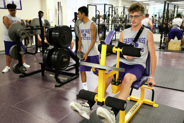 Austin Smith does leg exercises during Sabine Pass football athletics class on Wednesday afternoon. Smith is out with a possible broken wrist. Photo taken Wednesday 9/19/18 Ryan Pelham/The Enterprise