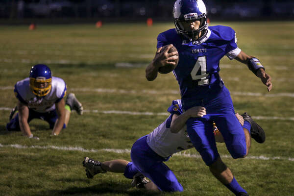 Coleman's Truman Webb carries the ball in a game against Ashley at the Comets' field last October. Ashley has since joined the growing ranks of schools opting to compete at the 8-man level, while Coleman is considering the possibility of someday doing the same.