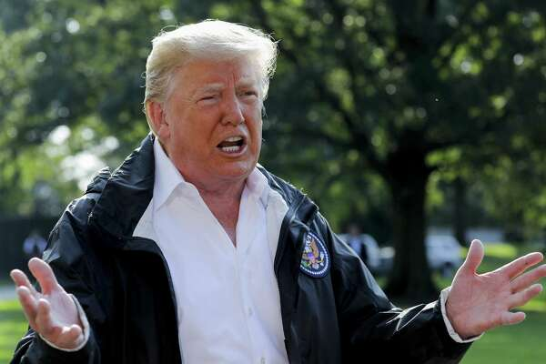 President Trump speaks to members of the media before boarding Marine One on the South Lawn of the White House on Wednesday as he headed to the survey storm damage in the Carolinas.
