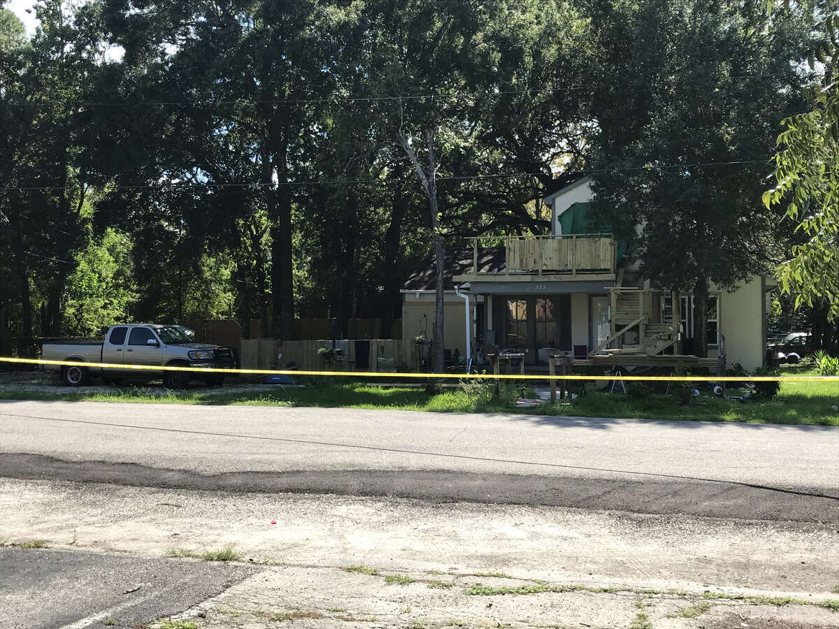 Police officers roped off the home of Royce Sedotal in League City on Wednesday. Sedotal was shot and killed after coming at a League City police officer with a