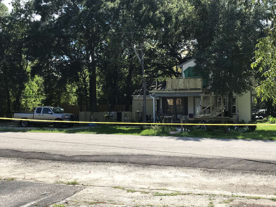 "Police officers roped off the home of Royce Sedotal in League City on Wednesday. Sedotal was shot and killed after coming at a League City police officer with a ""sharp-edged instrument."" Photo: Nick Powell"