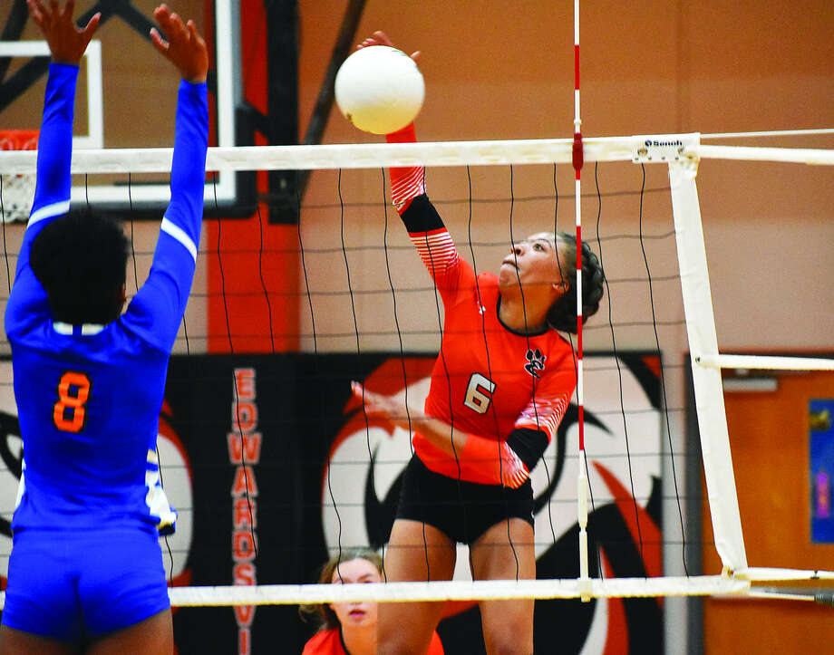 Edwardsville sophomore Alexa Harris slams down her 12th kill of the match against East St. Louis to complete a sweep on Wednesday inside Lucco-Jackson Gymnasium. Photo: Matthew Kamp