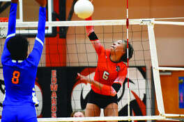 Edwardsville sophomore Alexa Harris slams down her 12th kill of the match against East St. Louis to complete a sweep on Wednesday inside Lucco-Jackson Gymnasium.