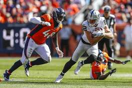 Oakland Raiders wide receiver Jordy Nelson (82) runs from Denver Broncos linebacker Shaquil Barrett (48) during the first half of an NFL football game, Sunday, Sept. 16, 2018, in Denver. (AP Photo/Jack Dempsey)