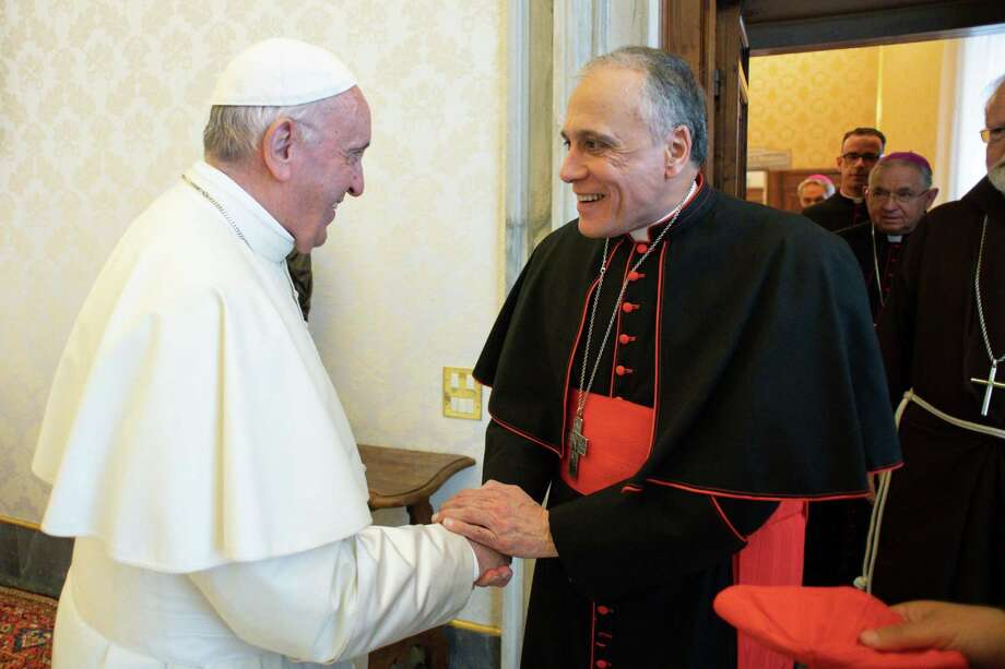 Pope Francis welcomes Cardinal Daniel DiNardo of Galveston-Houston at the Vatican on Sept. 13, 2018. The Archdiocese, alongside others in Texas, plans to release a list of names of priests accused of sexually abusing minors. Photo: HANDOUT, Handout / AFP/Getty Images / AFP or licensors