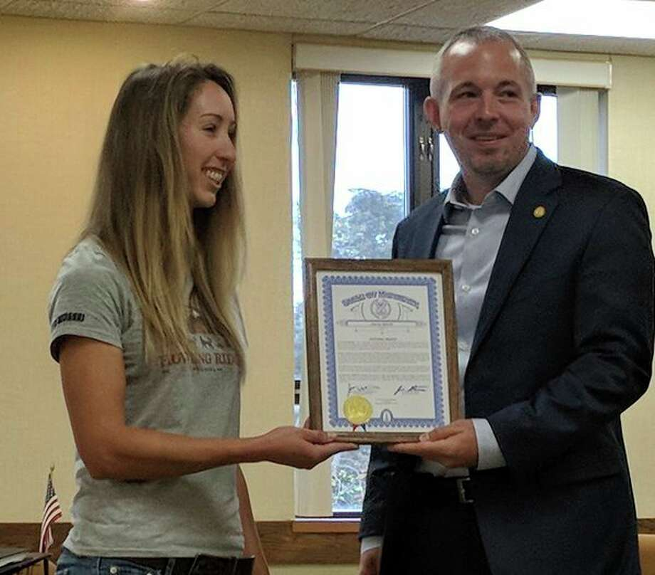 State Rep. Jason Wentworth honored Gladwin native Shaynee Traskawith a framed certificate on Friday at the Gladwin County Courthouse.The certificate recognizes Traska for becoming thefirst woman born and raised in Michigan to complete the Iditarod sled dog race in Alaska. (Tereasa Nims/for the Daily News)