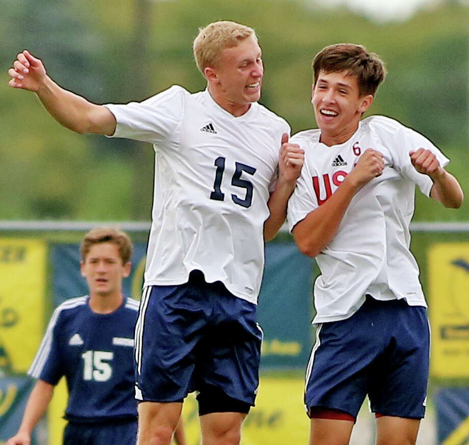 USA's Kris Nika (6) celebrates his first half goal with teammate Kyle Maust (15). It proved to be the only score of the game in the Patriots' 1-0 win over Bad Axe, Wednesday, in Bad Axe. (Paul P. Adams/Huron Daily Tribune)