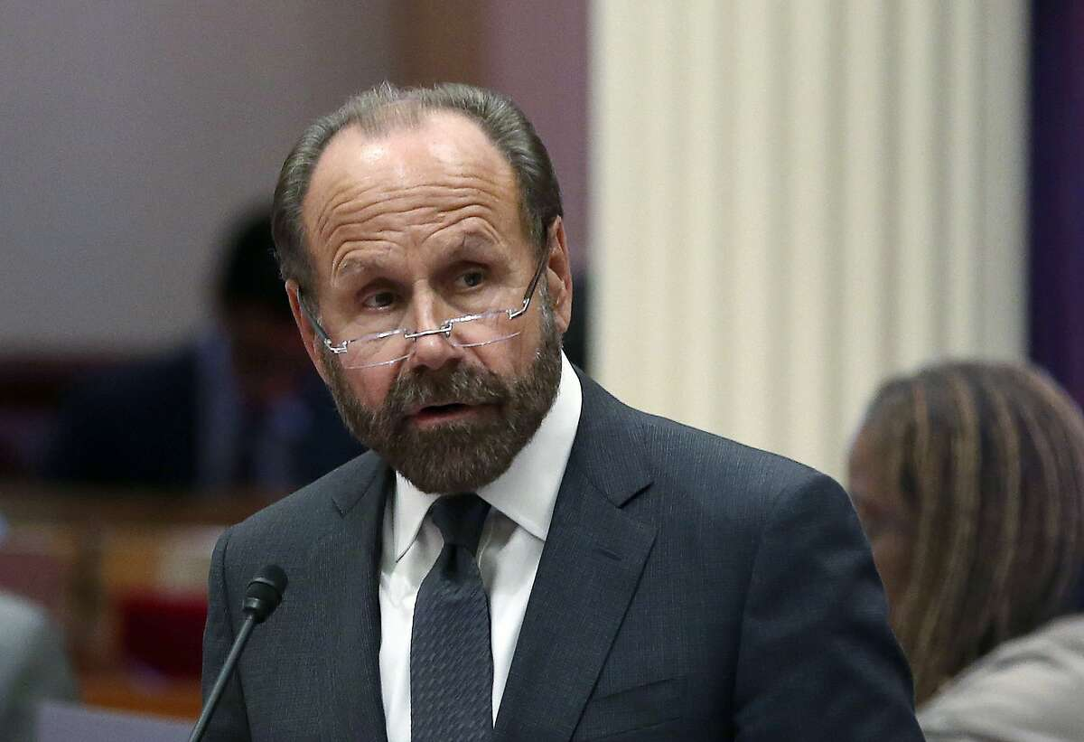 State Sen. Jerry Hill, D-San Mateo, speaks on the floor of the Senate, Monday, Aug. 27, 2018, in Sacramento, Calif. The state Assembly on Monday approved Hill's measure that allows parents to give their children medical marijuana on school campuses if school districts opt in. The bill was sent to Gov. Jerry Brown. (AP Photo/Rich Pedroncelli)