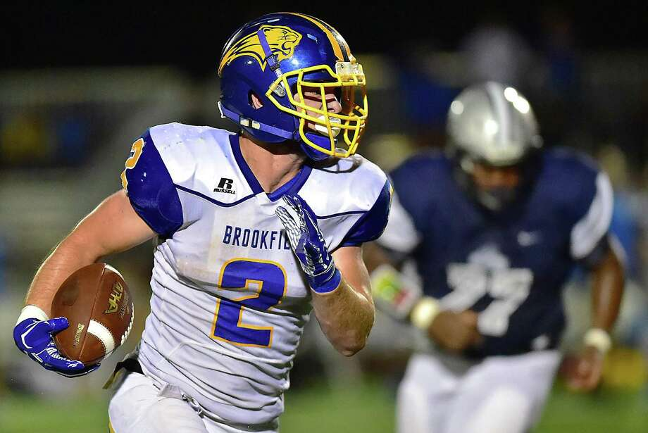 Brookfield senior Conor McVey gains yardage against Hillhouse on Friday at Bowen Field in New Haven. Brookfield won, 51-18. Photo: Catherine Avalone / Hearst Connecticut Media / New Haven Register