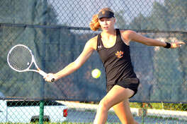 Edwardsville freshman Hannah Colbert makes a forehand return during her No. 5 singles match against Columbia (Mo.) Rock on Wednesday at Holt High School in Wentzville, Mo.