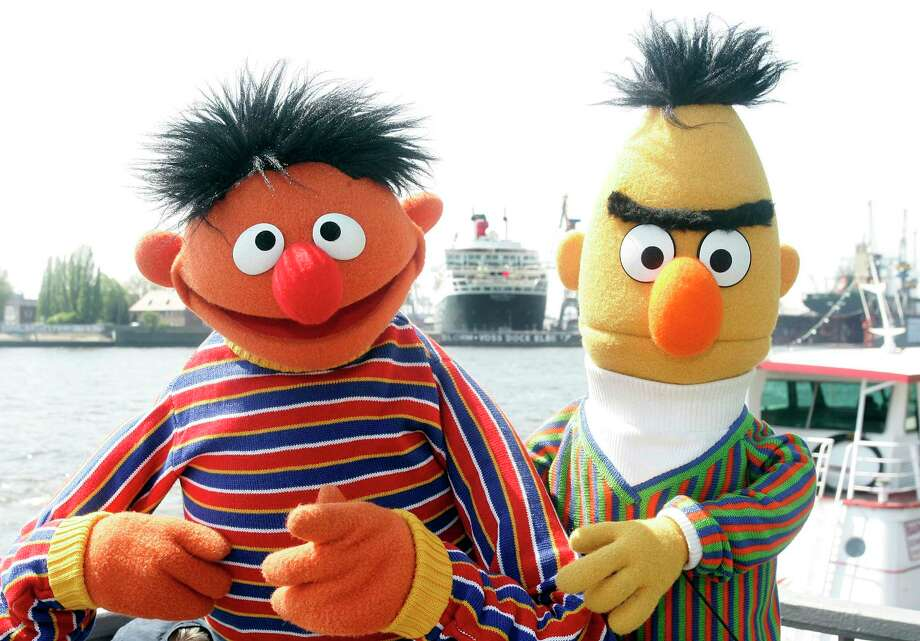 "FILE - In this May 9, 2006, file photo, Ernie and Bert of ""Sesame Street"" pose in front of the Queen Mary II in the harbor of Hamburg, Germany. The producers of ""Sesame Street"" tweeted Tuesday, Sept. 18, 2018, that Bert and Ernie are not gay in response to a Queerty interview published Sunday, Sept. 16, 2018, with a writer who said he considered the puppets lovers. (AP Photo/Fabian Bimmer, File) Photo: Fabian Bimmer / AP2006"