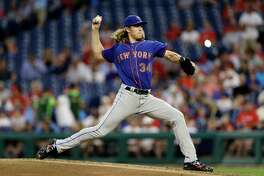 New York Mets' Noah Syndergaard pitches during the third inning of a baseball game against the Philadelphia Phillies, Wednesday, Sept. 19, 2018, in Philadelphia. (AP Photo/Matt Slocum)