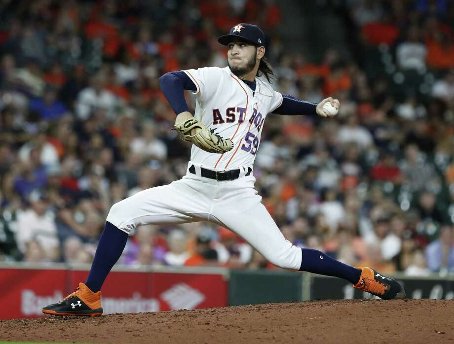 PHOTOS: Astros vs. Reds Houston Astros relief pitcher Cionel Perez (59) pirches during the seventh inning of an MLB baseball game at Minute Maid Park, Wednesday, September 19, 2018, in Houston. >>>See game action from the Astros' game against the Reds on Tuesday, June 18, 2019 ... Photo: Karen Warren, Houston Chronicle / Staff Photographer / © 2018 Houston Chronicle