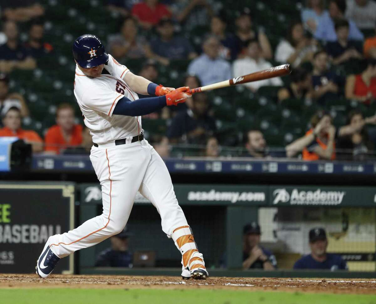 Houston Astros J.D. Davis (28) flies out during the eighth inning of an MLB baseball game at Minute Maid Park, Wednesday, September 19, 2018, in Houston.