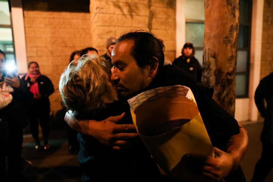 Ilyich Sato (right) hugs his mother Cristina Gutierrez (left) after being detained by the police outside the MIssion Police Department in San Francisco, California, on Wednesday, Sept. 19, 2018. Photo: Gabrielle Lurie / The Chronicle