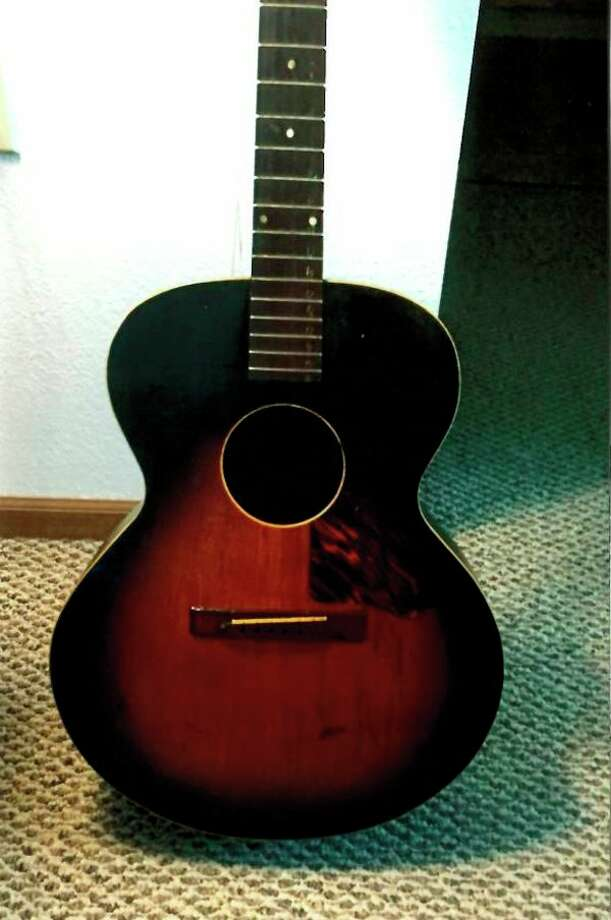 This is Claude Austin's Recording King guitar produced by Gibson and sold by Montgomery Ward for $9.75. Wayne has had it restored. He said, 'It will be something to look at and remember Dad.'
