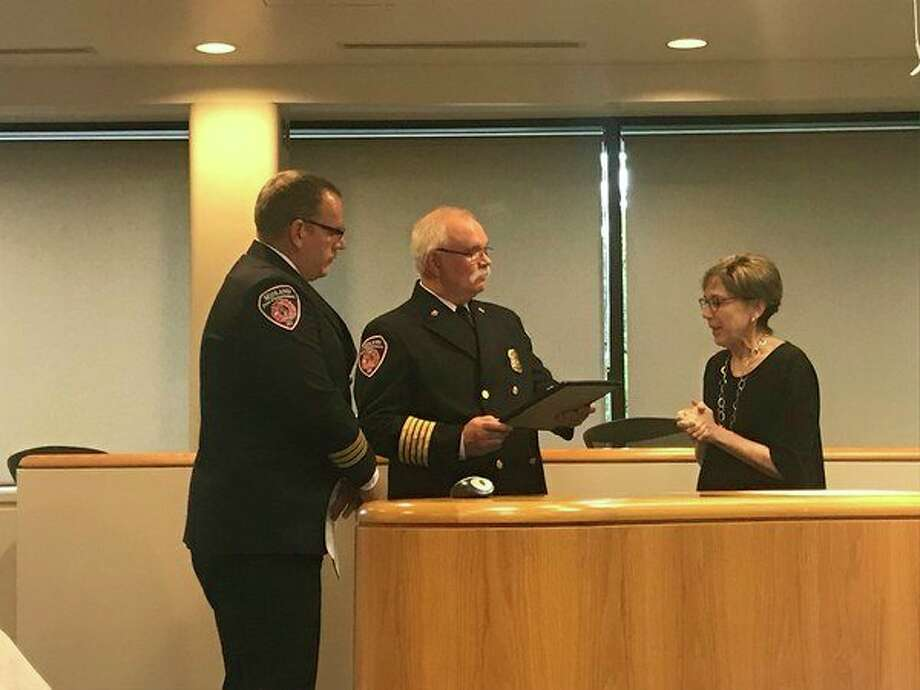 Midland Fire Marshal Tony Leo and Fire Chief Chris Coughlin accept a proclamation from City of Midland Mayor Maureen Donker on Monday, designating Fire Prevention Week Oct. 7-13 be recognized in Midland. (Kate Carlson/kcarlson@mdn.net)