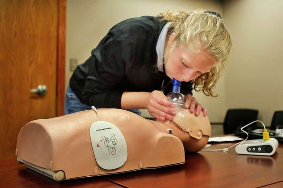 Saginaw Valley State University student Rylea Grassmid, 19, practices giving breaths during a CPR training session on Wednesday at Independent Community Living in downtown Midland. For more photos, go to www.ourmidland.com. (Katy Kildee/kkildee@mdn.net)
